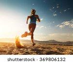 lady running in the desert   Shutterstock . vector #369806132