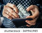 Hands Holding Us Dollar Bills...