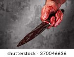 Male Hand With Bloody Knife...