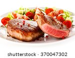grilled steaks and vegetable... | Shutterstock . vector #370047302