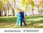 little girls running in autumn... | Shutterstock . vector #370054205