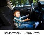 cute little boy driving fathers ...   Shutterstock . vector #370070996