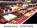 pastry shop. variety of cakes | Shutterstock . vector #370074602
