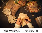 Female Hands Writing Christmas...