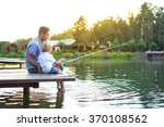father and son fishing on the... | Shutterstock . vector #370108562