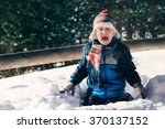 Little Boy On Snow Crying