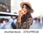 pretty woman eating an apple | Shutterstock . vector #370199018