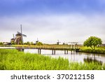 Windmills And Water Canal In...