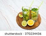 mojito on wooden background | Shutterstock . vector #370234436