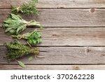 fresh garden herbs on wooden... | Shutterstock . vector #370262228