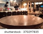 empty wood table top with blur...   Shutterstock . vector #370297835
