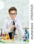 smart boy making researches in... | Shutterstock . vector #370319225