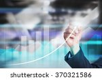 businessman drawing graphs on... | Shutterstock . vector #370321586