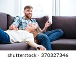 portrait of a laughing couple... | Shutterstock . vector #370327346