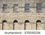 outside of prison with bars | Shutterstock . vector #370350236