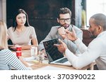 discussing some business issues.... | Shutterstock . vector #370390022