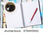 notebook pen and cup of coffee... | Shutterstock . vector #370445042