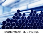 steel tubes against industrial... | Shutterstock . vector #370449656