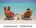 young couple is sitting on the... | Shutterstock . vector #370463126