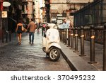 vintage scooter in old street... | Shutterstock . vector #370495232