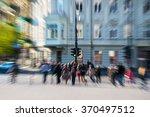 people crossing street in busy... | Shutterstock . vector #370497512