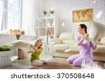 happy family  the mother and... | Shutterstock . vector #370508648