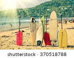 Small photo of Multicolored surfboards at Kata Beach in Phuket Island - Surf boards at tropical exclusive destination in south east Asia - Wonders of Thailand on vintage filtered look with enhanced sunshine