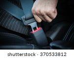 Hand Fastening Seat Belt In The ...