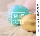 Stock photo pastel and colorful easter eggs with happy easter word holiday concept 370535825