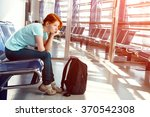 woman at the airport. waiting... | Shutterstock . vector #370542308