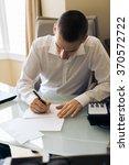 businessman in a hotel room | Shutterstock . vector #370572722