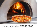 close up pizza in firewood oven ... | Shutterstock . vector #370582265