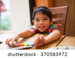 asian boy homework writing. | Shutterstock . vector #370583972