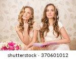 two beautiful happy girls... | Shutterstock . vector #370601012