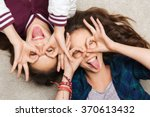 happy smiling pretty teenage... | Shutterstock . vector #370613432