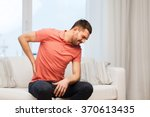 unhappy man suffering from... | Shutterstock . vector #370613435