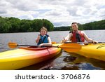 father and son enjoying kayaking | Shutterstock . vector #3706876
