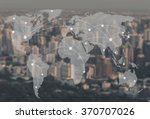 network and world map on blur... | Shutterstock . vector #370707026