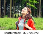 woman hiker in forest smiling... | Shutterstock . vector #370728692
