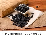 black raisins on a brown wooden ... | Shutterstock . vector #370739678