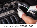 hands of car mechanic in auto... | Shutterstock . vector #370821845