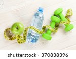 healthy food and fitness concept | Shutterstock . vector #370838396