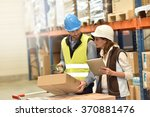 store manager with warehouseman ... | Shutterstock . vector #370881476