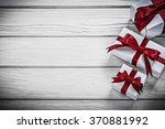 white present boxes on wooden... | Shutterstock . vector #370881992