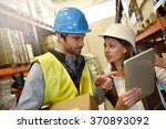 store manager with warehouseman ... | Shutterstock . vector #370893092