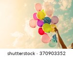 girl hand holding colorful... | Shutterstock . vector #370903352