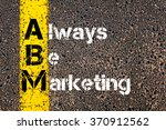 Small photo of Concept image of Business Acronym ABM ALWAYS BE MARKETING written over road marking yellow paint line.
