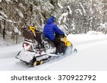 woman on a snowmobile moving in ... | Shutterstock . vector #370922792