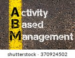 Small photo of Concept image of Business Acronym ABM Activity Based Management written over road marking yellow paint line.