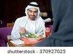 emirati arab couple dining in a ...   Shutterstock . vector #370927025